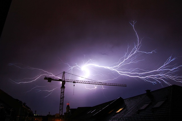 A crane struck by lightning in a thunderstorm